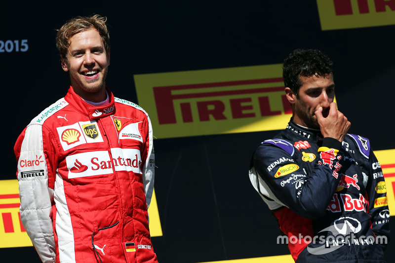 Race winner Sebastian Vettel, Ferrari celebrates on the podium with Daniel Ricciardo, Red Bull Racin