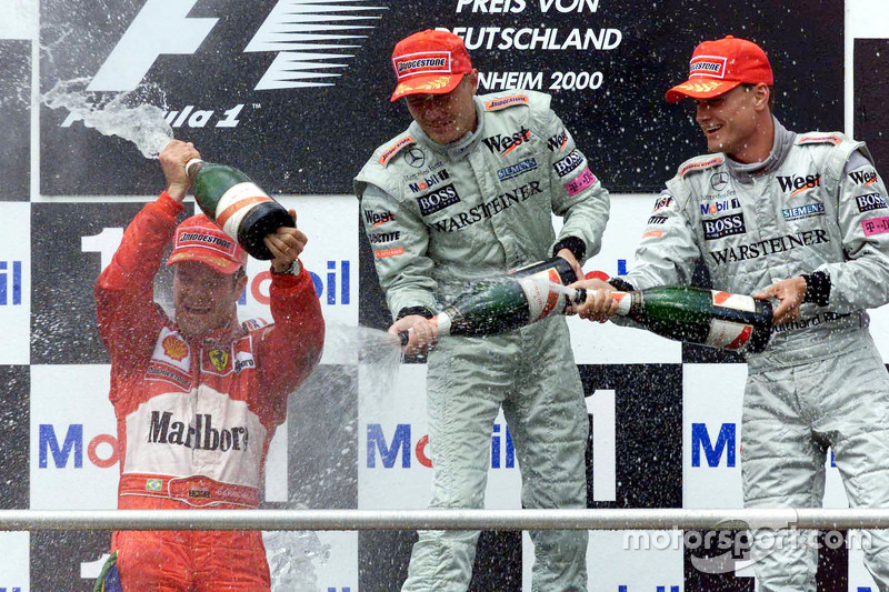 Podium: winner Rubens Barrichello, Ferrari and second place Mika Hakkinen and third place David Coul