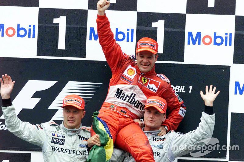 Podium: second place Mika Hakkinen, McLaren and winner Rubens Barrichello, Ferrari and third place D