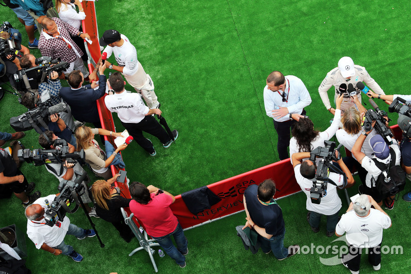 Lewis Hamilton, Mercedes AMG F1 and Nico Rosberg, Mercedes AMG F1 with the media