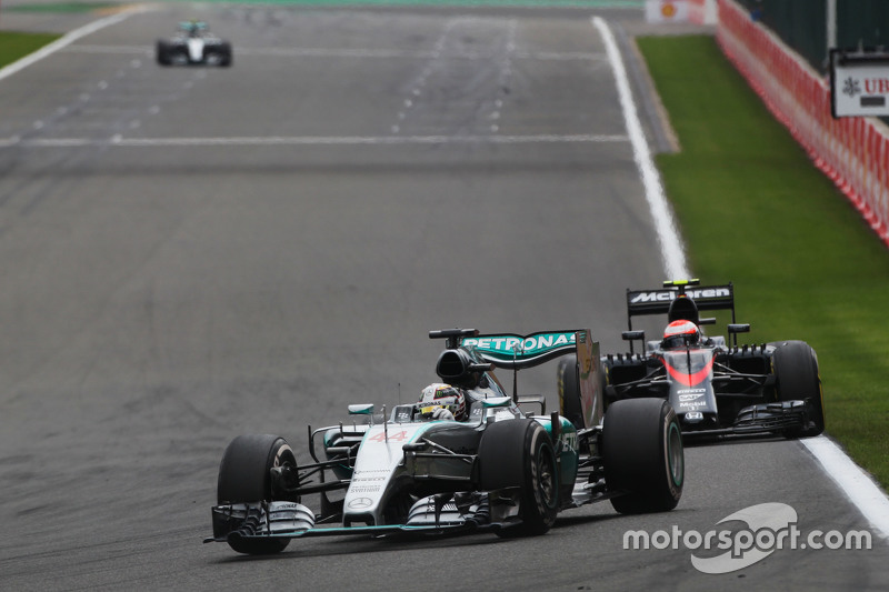 Lewis Hamilton, Mercedes AMG F1 W06 leads a lapped Jenson Button, McLaren MP4-31