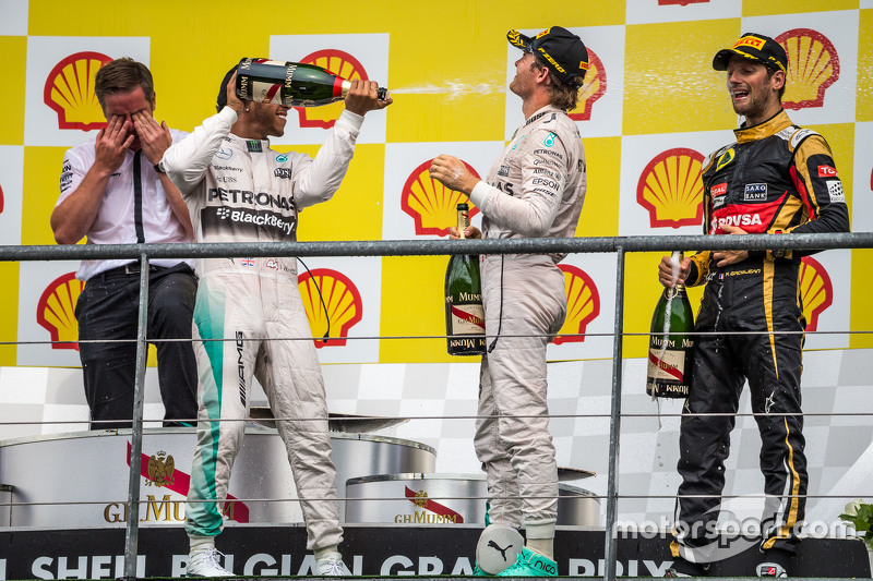 The podium,: race winner Lewis Hamilton, Mercedes AMG F1 celebrates with the champagne with second placed team mate Nico Rosberg, Mercedes AMG F1 and third placed Romain Grosjean, Lotus F1 Team