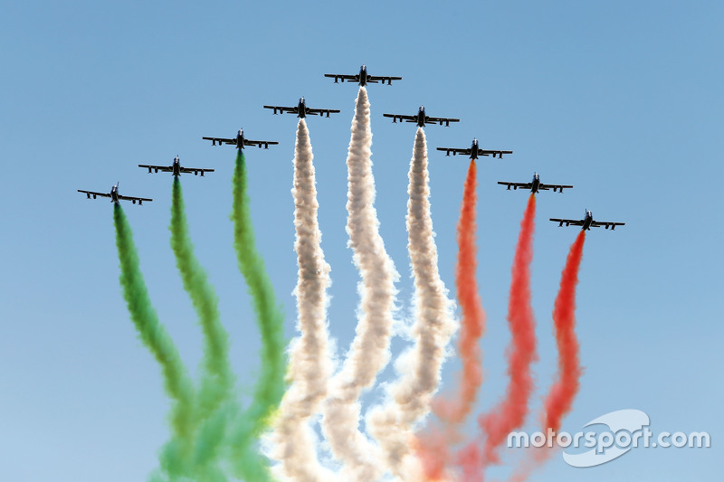 An air display flies over the circuit