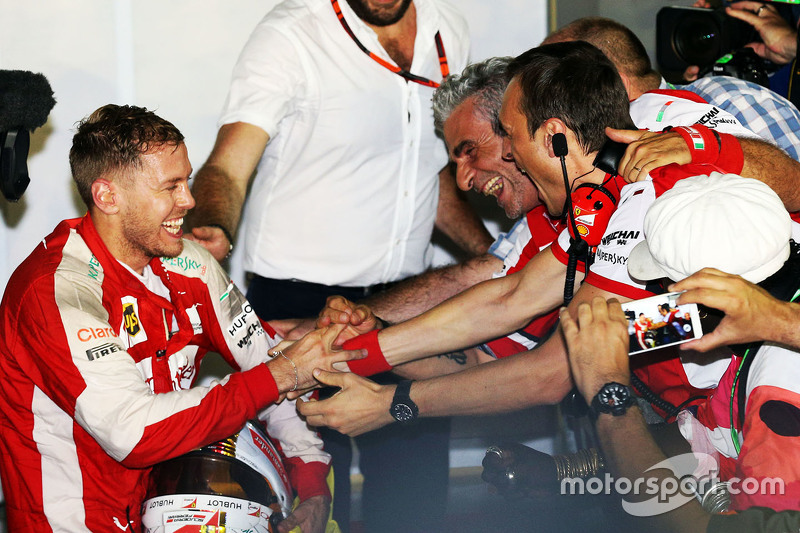 Race winner Sebastian Vettel, Ferrari celebrates with Maurizio Arrivabene, Ferrari Team Principal in