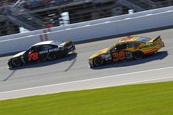 Martin Truex Jr., Furniture Row Racing Chevrolet and David Gilliland, Front Row Motorsports Ford