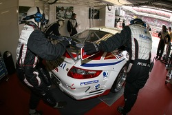 IMSA Performance Matmut team members push the car out