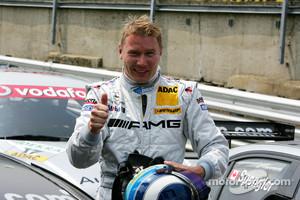 Pole winner Mika Häkkinen celebrates