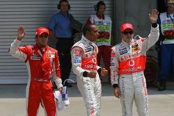 Felipe Massa, Scuderia Ferrari with Lewis Hamilton, McLaren Mercedes who gets pole position and Fernando Alonso, McLaren Mercedes