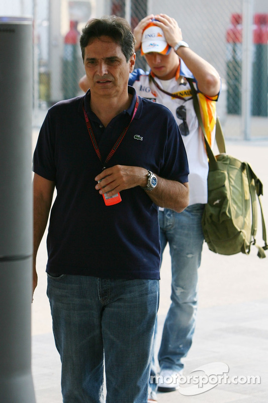 Nelson Piquet Snr., and Nelson Piquet Jr, Test Driver, Renault F1 Team in the background