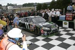 Victory lane: race winner Denny Hamlin enters victory lane