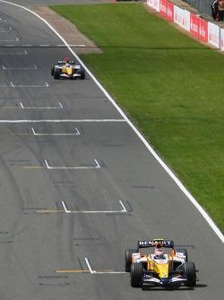 Heikki Kovalainen, Renault F1 Team, R27 and Giancarlo Fisichella, Renault F1 Team, R27