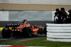 Adrian Sutil, Spyker F1 Team, F8-VII, passes photographers during the session