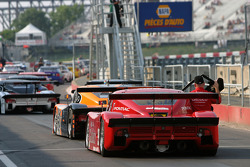 DP cars line up on pitlane