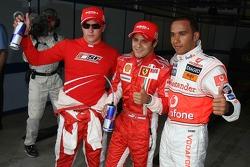Pole winner Felipe Massa celebrates with Lewis Hamilton and Kimi Raikkonen
