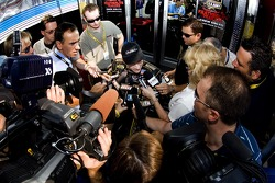 Mark Martin is surrounded by media