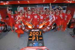 Celebrations at Ducati: 2007 MotoGP champion Casey Stoner and race winner Loris Capirossi celebrate with their team