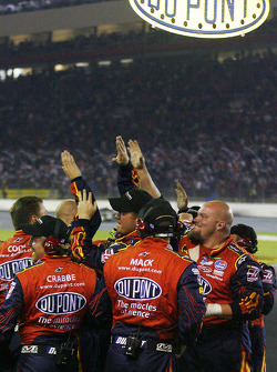 Dupont Chevy crew members celebrate as Jeff Gordon takes the checkered flag
