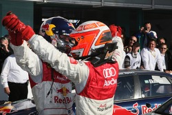 2007 DTM champion Mattias Ekström celebrates with Timo Scheider