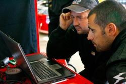 Team race engineer Brian Burns reviews data with Dario Franchitti