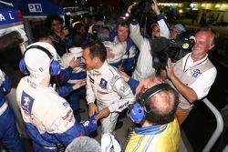 Stéphane Sarrazin celebrates 2007 Le Mans Series championship with Peugeot Total team members