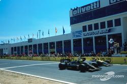 Ayrton Senna s'impose, 0.014 seconde devant Nigel Mansell