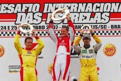 Podium: race winner Michael Schumacher with Luciano Burti and Lucas Di Grassi