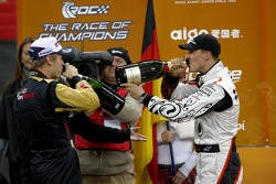 Michael Schumacher and Sebastian Vettel get the champagne on the podium
