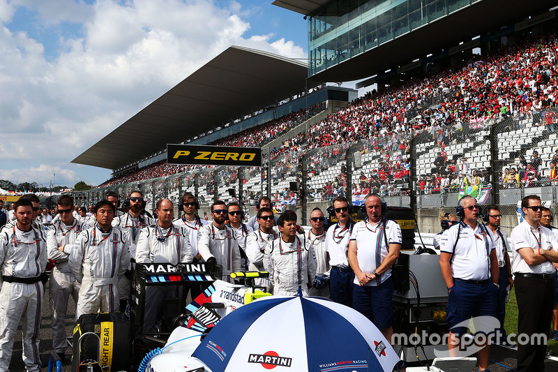 The crew of Valtteri Bottas, Williams FW37 as the grid observes the national anthem
