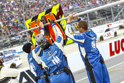 Crew members prepare the pit sign for Dale Earnhardt Jr., Hendrick Motorsports Chevrolet