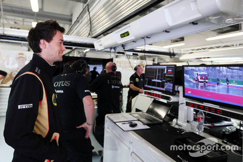 Jolyon Palmer, Lotus F1 Team Test and Reserve Driver watches the track clear up that delayed running in the first practice session