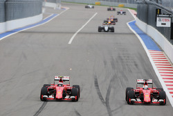 Kimi Raikkonen, Ferrari SF15-T and Sebastian Vettel, Ferrari SF15-T battle for position