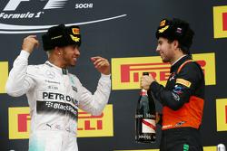 (L to R): Race winner Lewis Hamilton, Mercedes AMG F1 celebrates on the podium with third placed Sergio Perez, Sahara Force India F2