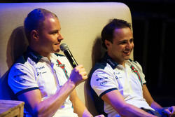 (Da sinistra a destra): Valtteri Bottas, Williams and team mate Felipe Massa, Williams al Fans' Forum