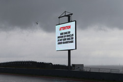 Heavy rainfall delays the start of FP2 as warning signs are displayed around the circuit