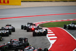 Lewis Hamilton, Mercedes AMG F1 W06 leads at the start of the race as Nico Rosberg, Mercedes AMG F1 W06 runs wide and Fernando Alonso, McLaren MP4-30 spins