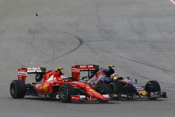 Kimi Raikkonen, Ferrari SF15-T and Carlos Sainz Jr., Scuderia Toro Rosso STR10 battle for position