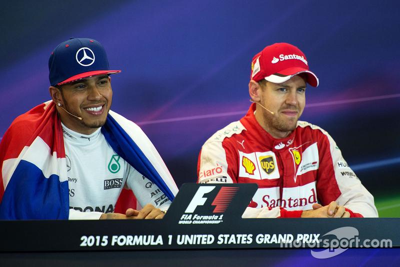 Race winner and World Champion Lewis Hamilton, Mercedes AMG F1 and third place Sebastian Vettel, Fer