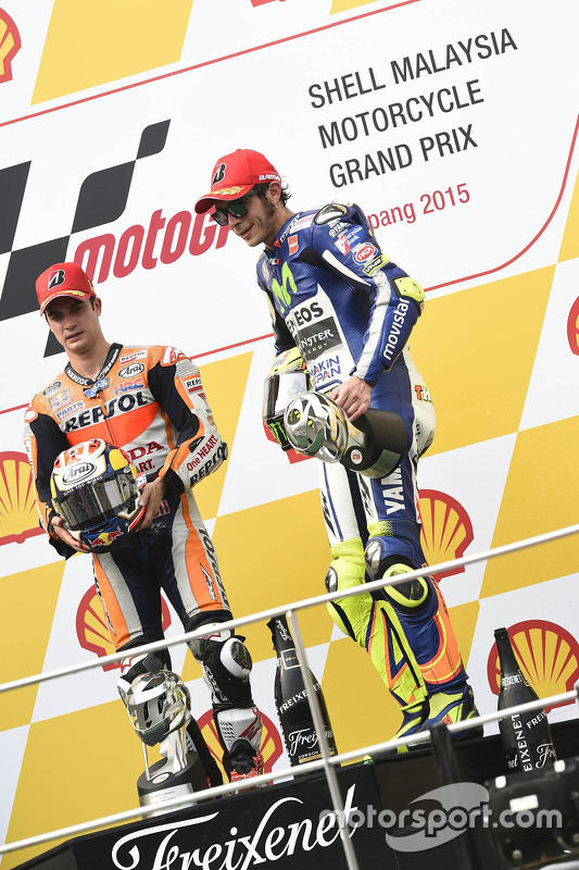 Podium: race winner Dani Pedrosa, Repsol Honda Team and third place Valentino Rossi, Yamaha Factory Racing