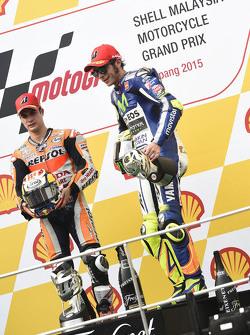Подіум: переможець гонки Дані Педроса, Repsol Honda Team та третє місце Валентіно Россі, Yamaha Factory Racing