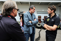 Gene Haas, Haas Automotion President with Guenther Steiner, Haas F1 Team Prinicipal and Romain Grosjean, Lotus F1 Team
