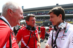 John Booth, Manor Marussia F1 Team Team Principal with Graeme Lowdon, Manor Marussia F1 Team Chief Executive Officer and Toto Wolff, Mercedes AMG F1 Shareholder and Executive Director on the grid
