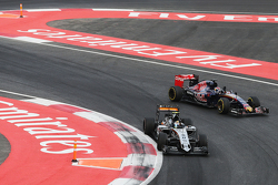 Sergio Perez, Sahara Force India F1 VJM08 and Max Verstappen, Scuderia Toro Rosso STR10 at the end of the race
