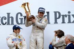 Podium: race winner Alan Jones, Williams, second place Jody Scheckter, Ferrari, third place Jacques Laffite, Ligier