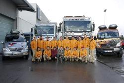 Team Fleetboard Dakar Leipzig presentation: Ellen Lohr and Antonia De Roissard, Stephan Schott and Holm Schmidt pose with Team Fleetboard Dakar team members and vehicles