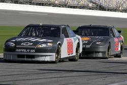 Dale Earnhardt Jr. and Kevin Harvick wait on pit road