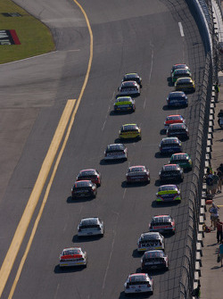 Race action as the field heads to turn 1
