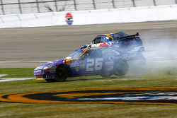 Jamie McMurray gets some air as he slides through the grass after losing control at the exit of turn 4