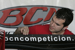 A BCN Competicion mechanic prepares one of the cars