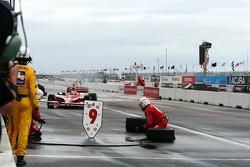 Target Chip Ganassi Racing crew member waves Scott Dixon in