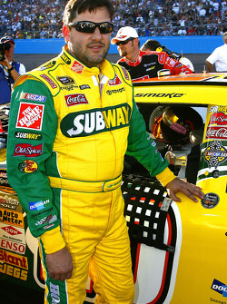 Tony Stewart poses next to the Brienne Davis decal on his Subway Toyota during pre race festivities